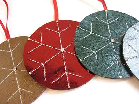 Handmade leather round stitched Christmas decorations by Emma Greenwood