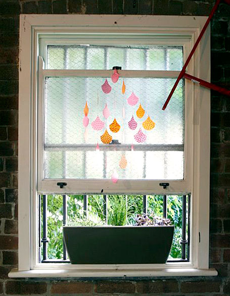 Printed Polypropylene Scales mobile hanging above the Polli herb garden