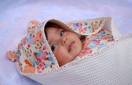 baby wearing sallymac waffle towel with Japanese cotton hood