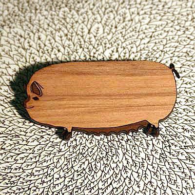 A Female Pig Brooch by Bonnie Poplar